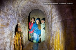 Kyiv underground tour - group of tourists inside the drain systen